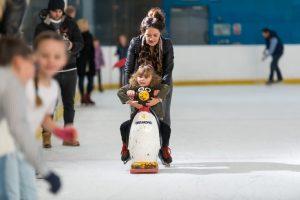 ice skating girl on penguin